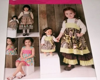 Dolly and Me Matching Front BIb Dress, Ruffle Pants and Shorts Pattern / NEW / UNCUT