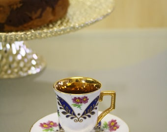 Pretty blue floral patterned miniature tea cup and saucer by Regal Porcelain