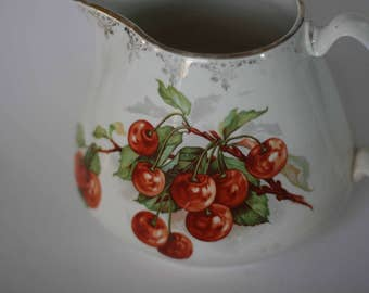 vintage ceramic cherry pitcher sterling china