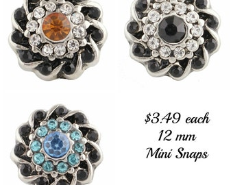Mini snap charms are 12.8 mm and work with Petite Ginger Snaps Jewelry plus other mini snap jewelry.