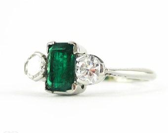 Vintage Emerald & Diamond Three Stone Engagment Ring, Emerald Cut Emerald with Round Brilliant Diamonds. PLAT, Circa 1940s.