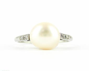 Antique Pearl & Diamond Engagement Ring. Edwardian Platinum Set White Cultured Pearl with Diamond Accents. Circa 1900s.