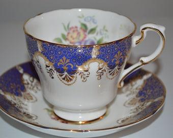 Paragon cup and saucer cobalt blue and gold fruit flower design vintage tea cup