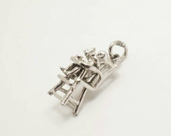 Vintage Sterling Movable Baby in a Highchair Charm