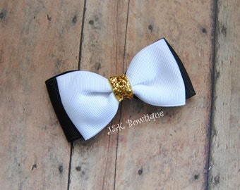 Double layer bow tie bow....Black and white with gold center