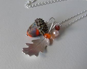 Silver oak leaf and burnt orange spotted glass acorn necklace