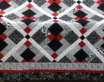 Quilt pattern;  Red, Black and White quilt Disappearing nine patch, queen size
