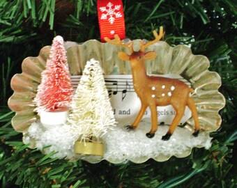 vintage oval tart tin Christmas ornament hymnal sheet music with plastic deer mini bottle brush trees snow