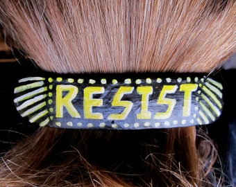 Barrette with the word Resist Handpainted in Yellow White on Black 70s Style Resistance Action French Hair Clip Pony Tail