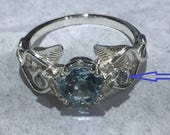 Upgrade for  14 K white gold Elvish ring to diamond center/ blue topaz sides.