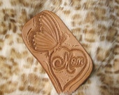 """Custom leather keychain with a hand tooled butterfly perched on a heart with """"Mom"""" script, Reserved for Annabella Pauley"""