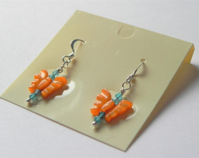 Coral coloured shell carved butterfly sterling silver drop earrings with blue quartzite.