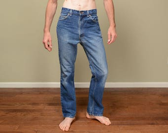 vintage 70s Levis 517 jeans distressed stonewash straight boot cut medium wash orange tab 1970 vintage Levi's 34 waist 34x30