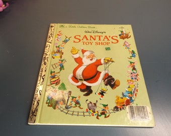 """Walt Disney's """"Santa's toy shop"""" book for kids of 1950 in excellent vintage condition .No marks, clean. A Little Golden Book Holiday. Gift."""