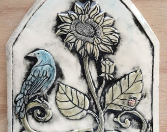Sunflower and bluebird porcelain arch tile in gloss finish for installation or wall hanging