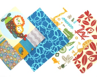 Quilt Square Clearance Grab Bag in Jungle Animals in Planes and on Wheels, Teal Bubbles, and Jungle Birds Matching Prints 50 Squares