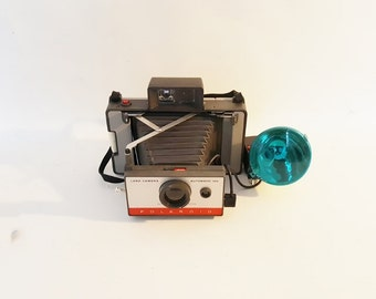 Vintage Photographic Equipment 1960 Polaroid Automatic 104 Land Camera With Flashgun Model 268 Instructions/Case Cold Clip