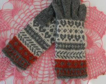 Hand knitted wool gloves. Patterned gloves. Grey, white. Woolen mittens. Warm gloves.