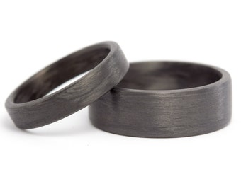 Set of two black carbon fiber wedding bands. Modern and unique flat rings. Water resistant, very durable and hypoallergenic. (00101_4N7N)