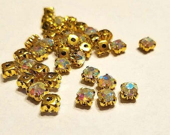 5 mm AB Sew on Rhinestones in Gold color settings. Glass Rhinestones. 30 Pieces.