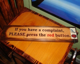 If you have a complaint, PLEASE press the red button. Hand painted sign