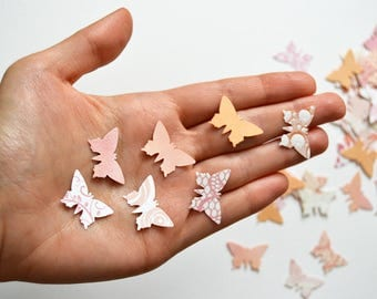 Handpunched butterflies in the shades of peach