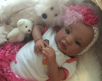 From the Biracial Shyann Kit Baby Girl Gabrielle Complete Baby Doll with Magnetic Pacifier