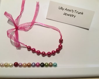 Beautiful faux pearl infant to adult pearl necklace and or bracelet.