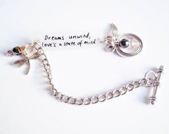 Dreams unwind, love's a state of mind bracelet