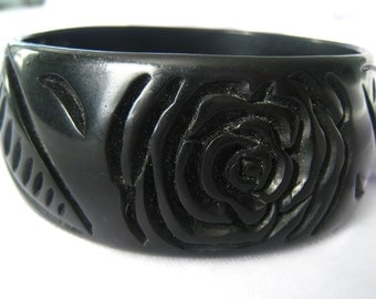 """Black Bangle with Carved Rose & Leaf Art Deco Design made to look like Bakelite.  1-3/16"""" W. (3 cm).  Diameter is 2-11/16"""" Across.."""