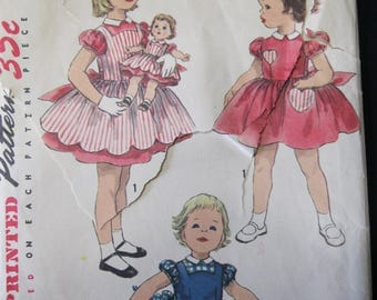 "Size 1, Simplicity 1745, Charming Dress and Pinafore, plus matching pattern for Sweet Sue and Binnie Dolls in heights of 15"" - 25"", 1956"