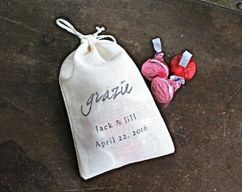 "Personalized wedding favor bags, 3x4.5. Set of 70 double drawstring muslin bags.  Italian ""Grazie"" in black on natural white cotton."