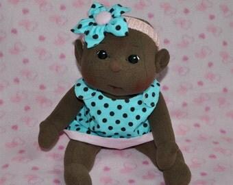 "Fretta's Flower BeBe Doll. Dark Skin, Black Eyes Bald Baby. 40.6 cm / 16"" Soft sculpture Baby Girl. Child Friendly Cloth Doll."