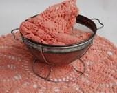 Grannys doilies. Grannys peach doilie collection. Crochet peach doilies. Cottage chic decor.