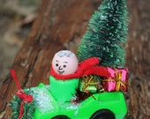 Cute Christmas decoration with Fisher Price Little People man and car, bottle brush tree; Christmas decor, holiday decoration