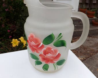 Vintage frosted glass pitcher decorated with hand painted roses