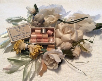 Vintage White Millinery Roses, Leaves, and Stamens collection. Mary's treasured Mini Thread in a box  and China Doll Head.