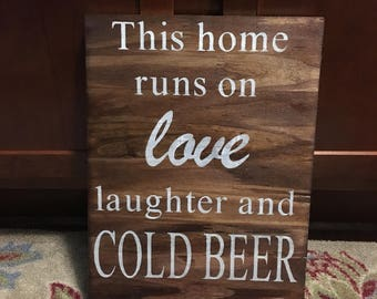 This home runs on love laughter and beer wood sign