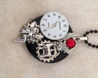 Steam Punk Pendant - on round black tile - clock face, angel wings, angel, cat, ruby jewel