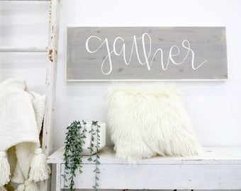 gather gray and white rustic wood sign
