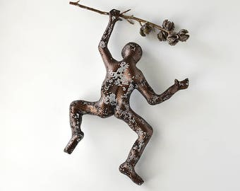 Climbing man sculpture on a tree branch, rustic wall decor, contemporary art, interior design, decorative art