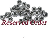 RESERVED for Lynne- round flat polymer clay fish bone beads with black and white stripes, set of 30