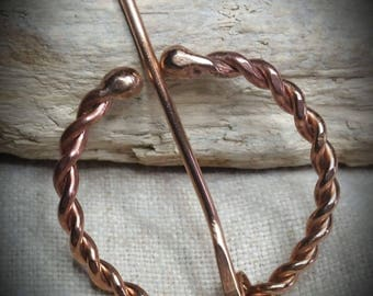 Bronze Viking twisted penannular brooch with balled ends
