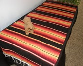 Black and Orange Mexican Serape Cloth Table Runner with fringe - Made from serape cloth - Buy now for Fall, Halloween and Thanksgiving