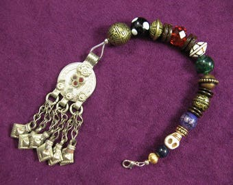 Long Pirate style beaded hair clip with tasseled pendant