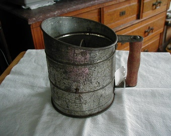 Old sifter with wooden handle and wooden knob.  Savory 500 sifter is the brand.