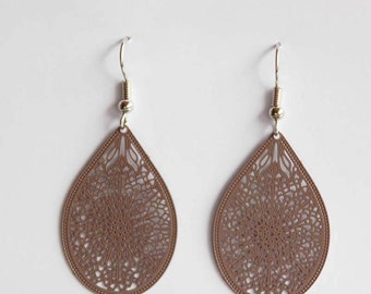 Large ornament earrings in dark brown