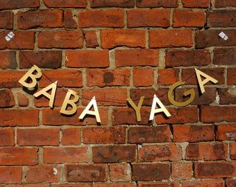 BABA YAGA letter banner - John Wick inspired gold paper banner, supernatural bogeyman, Slavic folklore, Keanu Reeves film, mythology, witch
