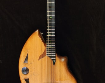 Nylon string acoustic guitar, Handmade musical instrument. By Rays Rootworks. Fibonacci shape.
