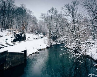 A snow covered railroad track and creek in rural Carroll County, Maryland. | Photo Print, Stretched Canvas, or Metal Print.